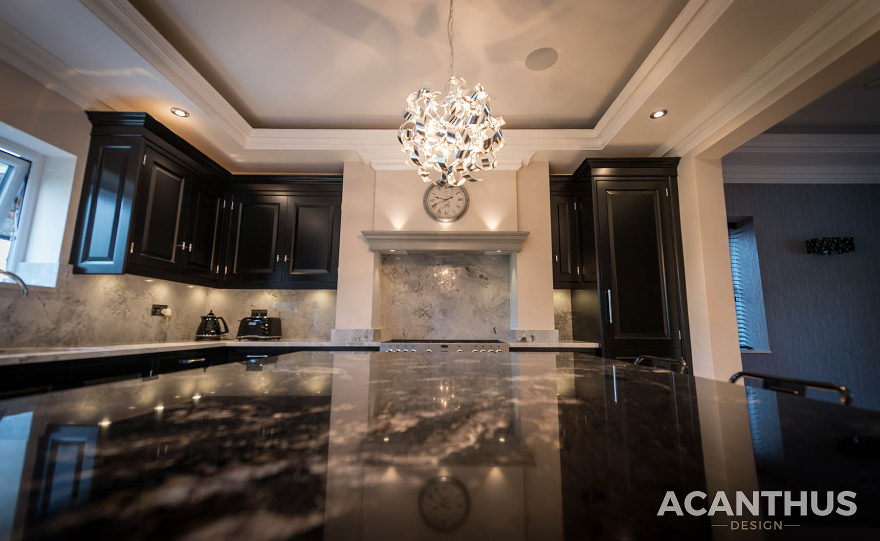 Acanthus Design kitchen Featuring Cosmic Black & Super White Granite Kitchen Worktops