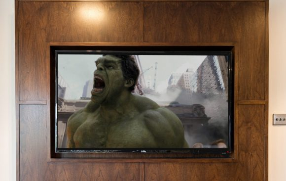 Walnut Audio Visual Furniture Panel Displaying The Movie Hulk